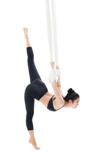 Young Chinese woman practicing aerial yogaの写真素材 [FYI02856915]