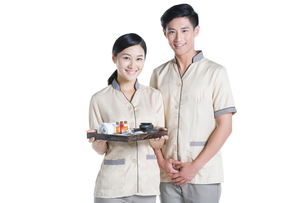 Massage therapists holding massage suppliesの写真素材 [FYI02857440]