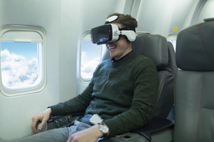 Male passenger using virtual reality headsetの写真素材 [FYI02857624]