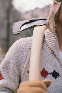 Close up of a man carrying an axe on his shoulder.の写真素材 [FYI02857813]