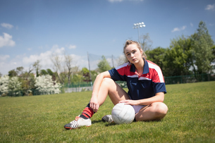 Portrait of woman with soccer ball on fieldの写真素材 [FYI02857941]