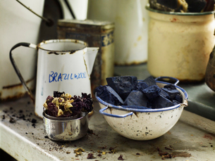 Ingredients in a bowl to create a natural dye. Indigo pigment in blocks.の写真素材 [FYI02857966]