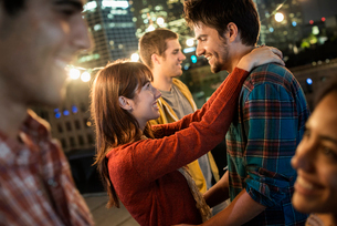A group of men and women at a rooftop party.の写真素材 [FYI02858174]