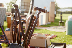 Selection of wooden canes and walking sticks for sale at an open air flea market stall.の写真素材 [FYI02858181]