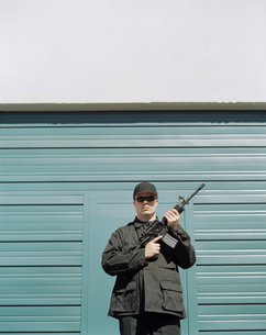 Man wearing special forces uniform and holding high powered semi-automatic rifleの写真素材 [FYI02858314]