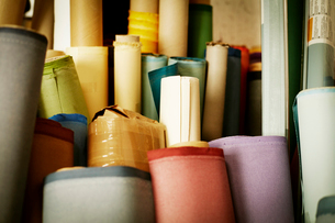 Rolls of materials, fabric and leather used in book binding.の写真素材 [FYI02858500]