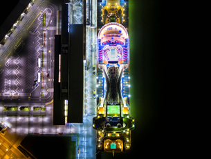 A large commercial passenger cruise ship seen from above, with decks and outside desk space light upの写真素材 [FYI02858534]