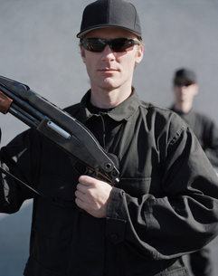 Men in special forces, holding high powered shotgun rifleの写真素材 [FYI02858579]