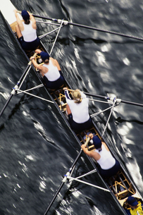 Overhead view of a female rowing crew in their racing shell, rowing boat.の写真素材 [FYI02858620]