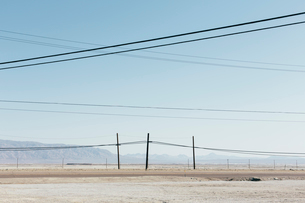 Telephone poles and power lines near Trona, California, USA.の写真素材 [FYI02858639]
