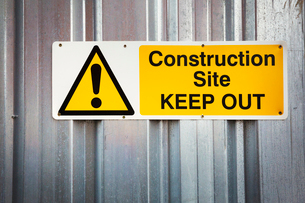 A fence of corrugated iron, a construction site boundary. Safety notices.の写真素材 [FYI02858671]