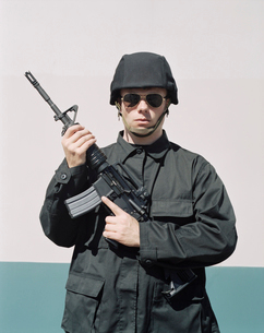 Man wearing special forces uniform and holding high powered semi-automatic rifleの写真素材 [FYI02858759]