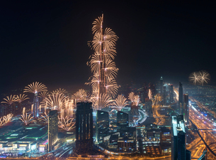 Cityscape of Dubai, United Arab Emirates at night, with fireworks and illuminated skyscrapers.の写真素材 [FYI02858814]