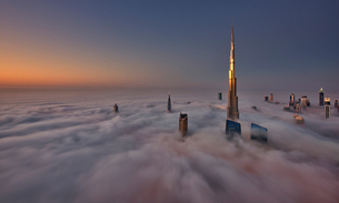 View of the Burj Khalifa and other skyscrapers above the clouds in Dubai, United Arab Emirates.の写真素材 [FYI02858843]