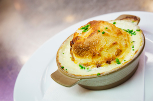 Close up of a cheese souffle in a ramekin.の写真素材 [FYI02858846]