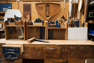 Work bench in a boat-builder's workshop, selection of hand tools for wood working.の写真素材 [FYI02858863]