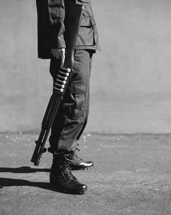 Cropped view of man in special forces, holding high powered shotgunの写真素材 [FYI02858959]