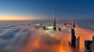 View of the Burj Khalifa and other skyscrapers above the clouds in Dubai, United Arab Emirates.の写真素材 [FYI02859060]