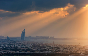 Cityscape of Dubai, United Arab Emirates at dusk with the Burj Al Arab skyscraper in the distance.の写真素材 [FYI02859314]
