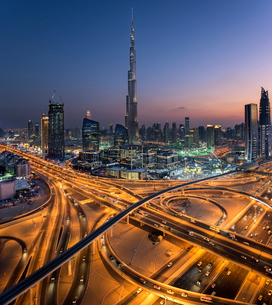 Cityscape of Dubai, United Arab Emirates at dusk, with the Burj Khalifa skyscraper and illuminated hの写真素材 [FYI02859338]