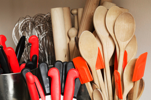 Selection of cooking utensils, wooden spoons, spatulas, rolling pins, whisks and kitchen knives.の写真素材 [FYI02859407]