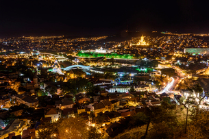 View across the city of Tbilisi, Georgia at night.の写真素材 [FYI02859429]