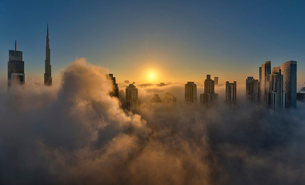 View of the Burj Khalifa and other skyscrapers above the clouds in Dubai, United Arab Emirates.の写真素材 [FYI02859506]