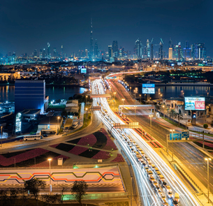 Cityscape of the Dubai, United Arab Emirates at dusk, with highway across the marina and skyscrapersの写真素材 [FYI02859512]