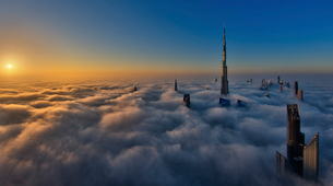View of the Burj Khalifa and other skyscrapers above the clouds in Dubai, United Arab Emirates.の写真素材 [FYI02859521]