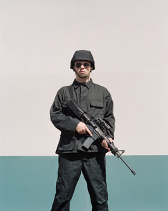 Man wearing special forces uniform and holding high powered semi-automatic rifleの写真素材 [FYI02859532]