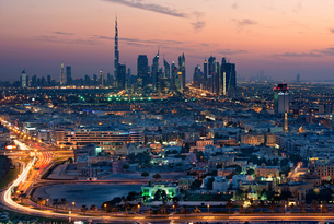 Cityscape of the Dubai, United Arab Emirates at dusk, with highway in the foreground and skyscrapersの写真素材 [FYI02859571]