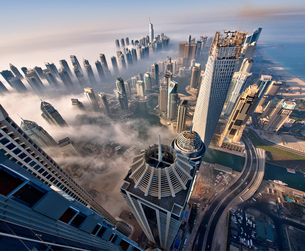 Aerial view of cityscape with skyscrapers above the clouds in Dubai, United Arab Emirates.の写真素材 [FYI02859582]