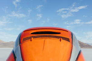 Vintage orange VW Beetle parked on the Salt Flatsの写真素材 [FYI02859583]