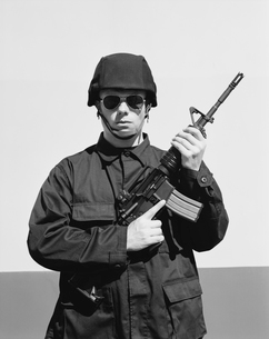 Man wearing special forces uniform and holding high powered semi-automatic rifleの写真素材 [FYI02859713]