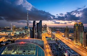 Cityscape with illuminated skyscrapers, Dubai, United Arab Emirates at dusk.の写真素材 [FYI02859720]