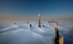 View of the Burj Khalifa and other skyscrapers above the clouds in Dubai, United Arab Emirates.の写真素材 [FYI02859942]