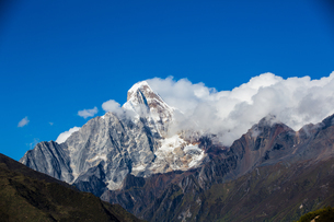 White cloud floating on the Mount Siguniang;Sichuan; Chinaの写真素材 [FYI02861135]