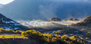 Sunlight shadow with mist and cloud on the village in Meili Snow Mountainの写真素材 [FYI02861392]