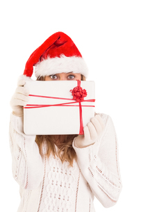 Festive blonde holding a giftの写真素材 [FYI02877915]