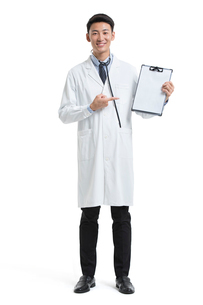 Cheerful young Chinese doctor with medical recordの写真素材 [FYI02878076]