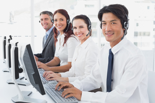 Employees typing on their computersの写真素材 [FYI02878691]