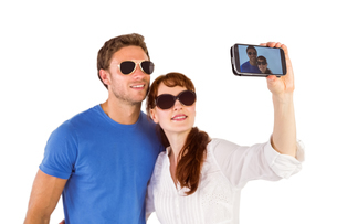 Couple using camera for pictureの写真素材 [FYI02878811]