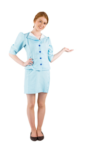 Pretty air hostess presenting with handの写真素材 [FYI02880372]
