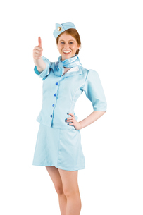 Pretty air hostess with hand on hipの写真素材 [FYI02880452]