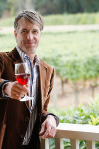Mid adult man toasting with red wineの写真素材 [FYI02939501]