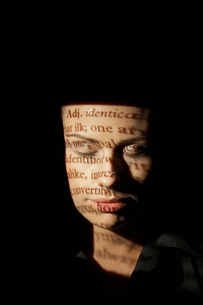 Text projected on womans faceの写真素材 [FYI02939745]