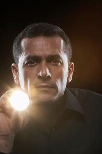 Man holding torchの写真素材 [FYI02940066]
