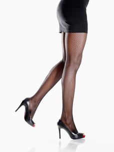 Woman wearing miniskirt and stilettosの写真素材 [FYI02940370]