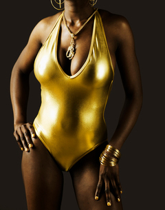 Young Woman in Golden Swimming Costumeの写真素材 [FYI02941497]