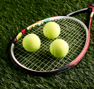 Tennis Balls on Racketの写真素材 [FYI02941980]